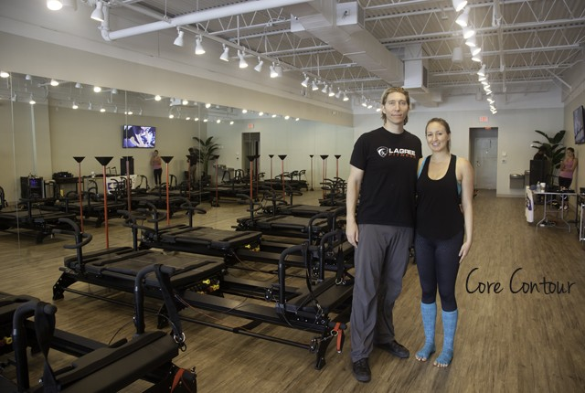 Sebastien Lagree and Jen Capps pose in front of the Megaformer in the new studio called Core Contour in Fort Lauderdale